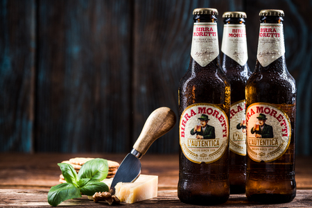 TARNOW, POLAND - SEPTEMBER 24, 2018:  Frozen bottles of Italian beer Birra Moretti, product still life. Editorial