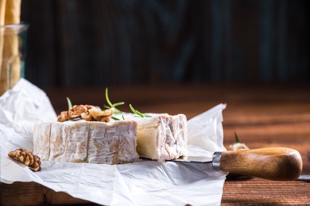 Serving camembert cheese, festive Christmas food.