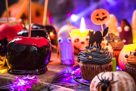 Candy apples and sweet food for Halloween.