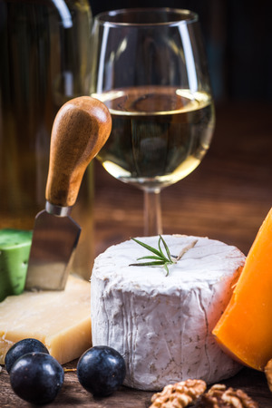 Cheese with white wine, festive food.