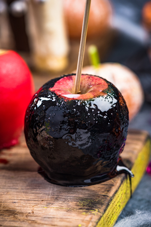 Black candy apple,Halloween food. Stock Photo