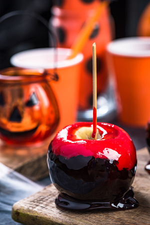 Red candy apple, Halloween food.
