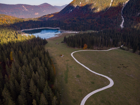 Aerial view over road leading into Fusine Lakes,Italy.