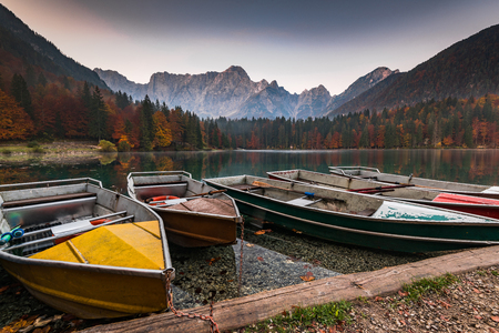 Turist boats at Fusine Lakes in Italy.