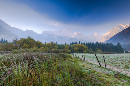 Cold atumn morning at sunrise with Julian Alps in background. Stock Photo