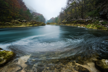 Long exposure image of Una river flow in Bosnia. Фото со стока