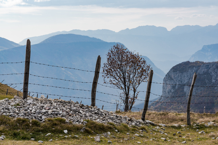 Old fence and pasture border in remote Bosnia mountains.