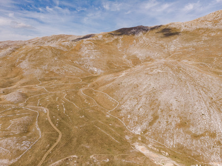 Rolling hills in rural Bosnia, aerial drone view. Imagens
