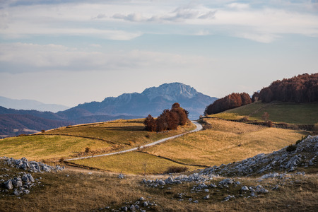 Rural road in remote Bosnia mountains at autumn.