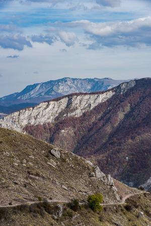vista over atumnal woodlans in Bosnia mountains.