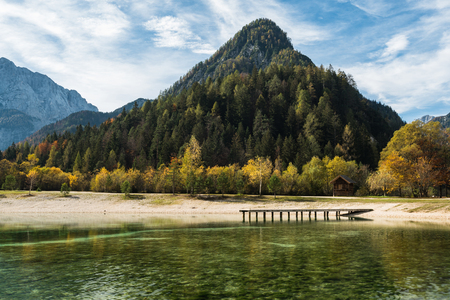 Turquoise water and colorful mountains at Jasna lake in fall,Slovenia. 스톡 콘텐츠