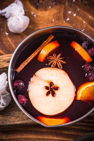 Pan with hot mulled wine, Christmas festive drinks.