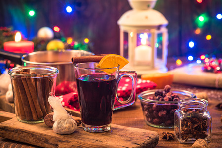 Mulled wine , Christmas festive warming drink on decorated table. Stock Photo