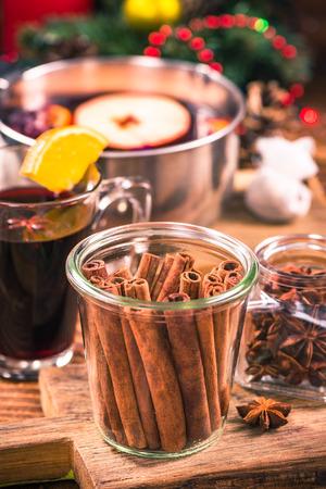 Cinnamon sticks in jar, festive Christmas spice. Stock Photo