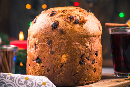 Panettone cake on festive table. Traditional Christmas food.