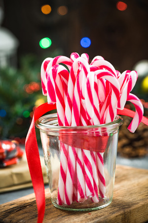 Jar with festive candy cane on christmas table. Stock Photo