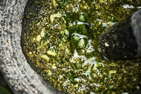 Basil pesto in granite mortar, close up view. 版權商用圖片