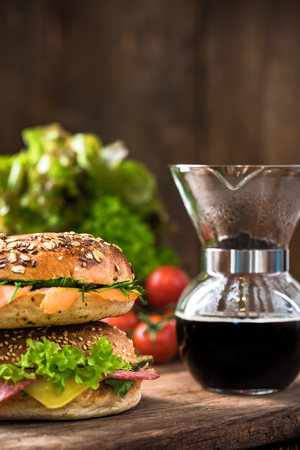 Fresh healthy bagels and coffee in dipper.