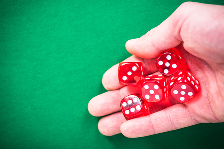 Hand throwing red dices, good luck concept.
