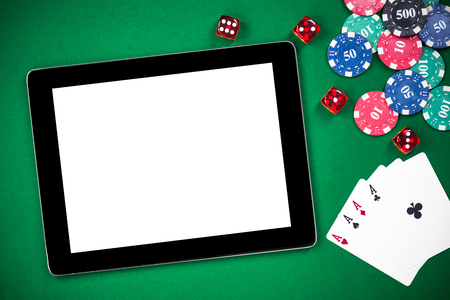 Mock up template tablet on casino poker table. Stock Photo
