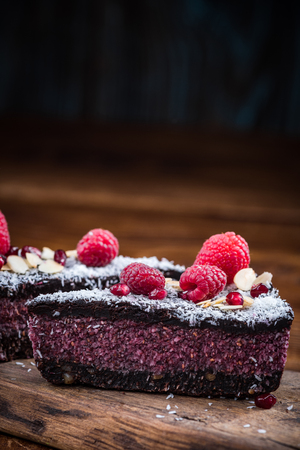 Raspberry, chia and pomegranate seeds cake. 스톡 콘텐츠