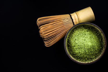 Bowl with Matcha tea and bamboo whisk. Copy space. Reklamní fotografie