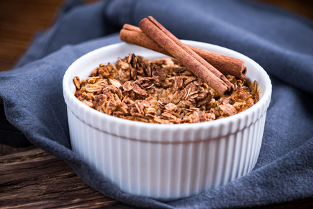 Baked apple pie with oats in pot.