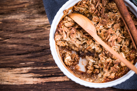 Baked apple with oats, homemade healthy dessert.