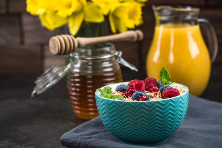 Muesli in bowl with fresh berry fruits. Stock Photo
