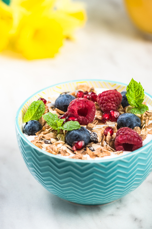 Serving portion of healthy granola with fruits. Stock Photo