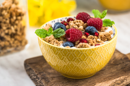 Breakfast or brunch, granola with milk and berry fruits. Stock Photo