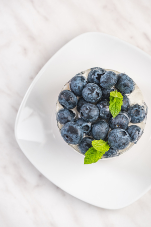 Blueberry cheesecake with mint, top view. Stock Photo - 119921506