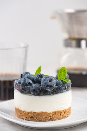 Serving homemade blueberry cheesecake.