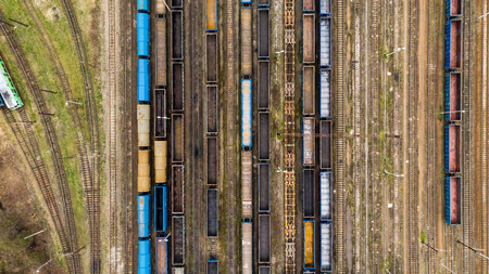 Cargo trains close-up. Aerial view of colorful freight trains on the railway station.  Top view from flying drone