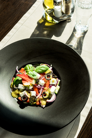 Fresh salad served on restaurant table.