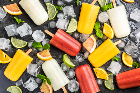 Fresh fruit juice ice lolly pops ice cream.background.