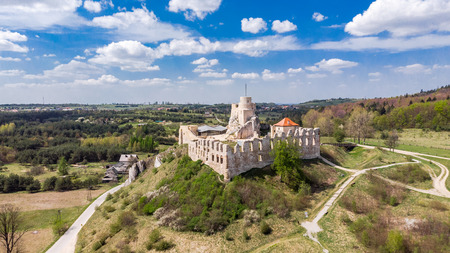 Aerial view of medieval Rabsztyn Castle ruins on hill top in sunny day, in Poland.