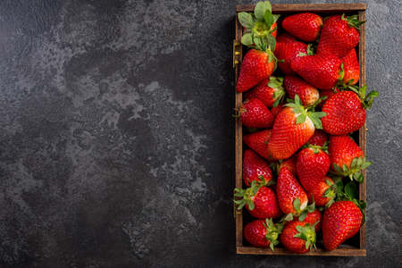 Wooden box with market fresh strawberries.