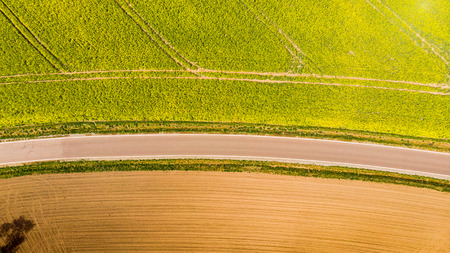 Abstract pattern in farmland fields at spring, aerial  view, drone photo. Stock Photo