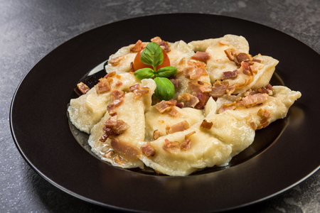 Traditinal Polish meat dumplings, served on plate in restaurant. Stock Photo