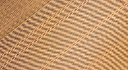 Aerial view, Rows of soil before planting,row pattern in a plowed field  in spring.Horizontal view in perspective