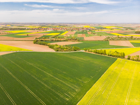 Colorful agricultural fields at spring, aerial drone view. 스톡 콘텐츠