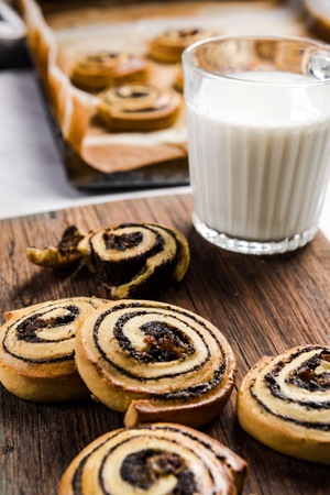 Cinnamon rolls served with glas of milk.