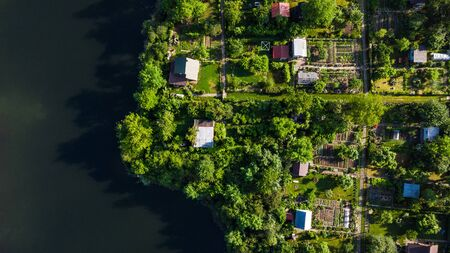 Tiny Ecological Friendly City Plot Gardens on Lake Edge, Aerial Top Down View.