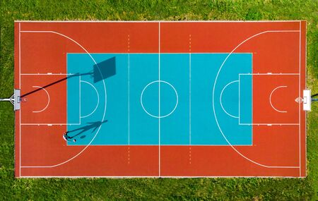 Man Play Basketball on Outdoor Court, Creative Aerial Drone Image. Stock Photo