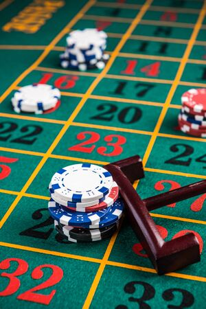 Betting casino chips on lucky number, roulette gambling.