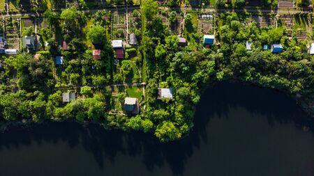Small Plot Garden on Lake Edge in tarnow, Poland, Aerial Drone View. Reklamní fotografie