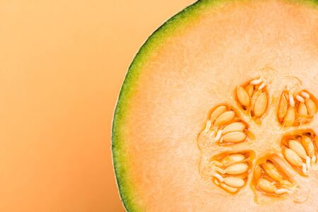 Cantaloupe Orange Melon Sliced in Half on Pastel Background,Close Up Detail.