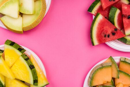 Watermelon and Melon Slices on Plate, Top View on Pink Pastel Background, Flat Lay. Stock fotó