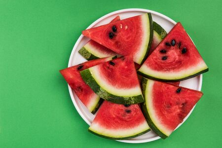 Fresh Watermelon Sliced in Triangles on Plate, Pastel Background and Copy Space.